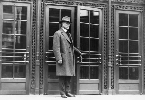 Publisher George G. Booth stands at the entrance to the newly opened Detroit News building in 1917, the year after the paper set forth its standards in a style book. (Detroit News photo)